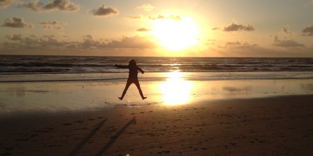 Chantal Soeters on the beach at sunset